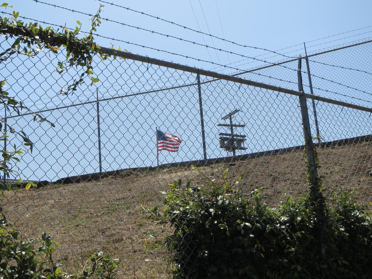 american-flag-behind-fence